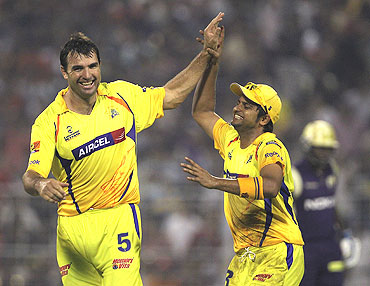 Justin Kemp and Suresh Raina celebrate after dismissing Sourav Ganguly