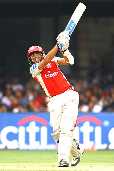 Manvinder Bisla of Kings XI Punjab hits a six