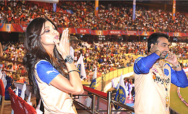 Shilpa Shetty Co-owner of the Rajasthan Royals with husband Raj Kundra looks on from the stands