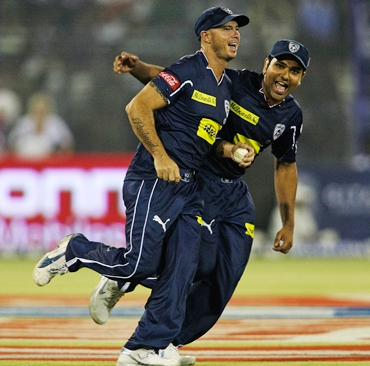 Herschelle Gibbs and Rohit Sharma celebrate the dismissal of Yuvraj