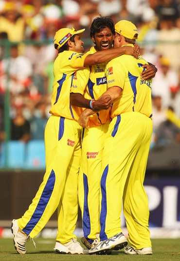 Laxmipathy Balaji is congratulated by Raina and Hayden after dismissing Warner