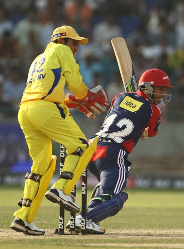 Wicketkeeper Parthiv Patel watches Mithun Manhas guide the ball to the boundary