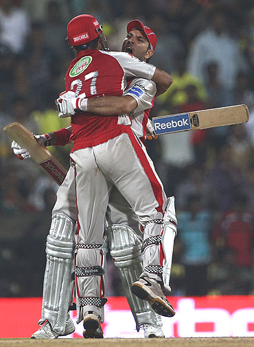Yuvraj Singh and Irfan Pathan embrace after defeating Chennai Super Kings
