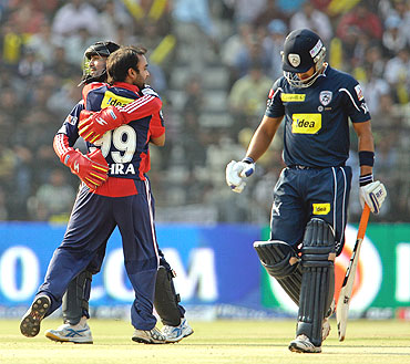 Delhi Daredevils' Amit Mishra and captain Dinesh Karthik celebrate the wicket of Mohnish Mishra (right)
