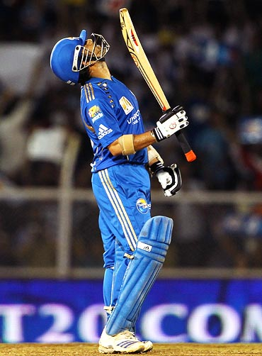 Sachin Tendulkar celebrates his half-century
