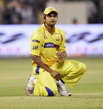 Suresh Raina the captain of Chennai looks on as a ball goes to the boundary