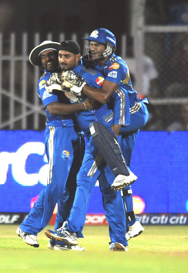 Harbhajan Singh celebrates after picking up Hayden