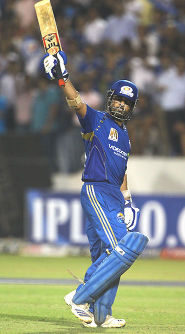 Sachin Tendulkar celebrates after reaching his half century