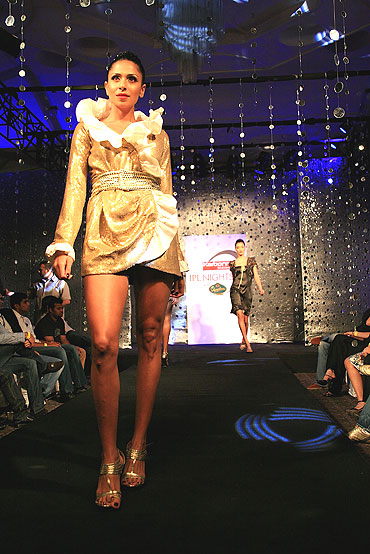 A model walks the runway during the Ramona Narang fashion show
