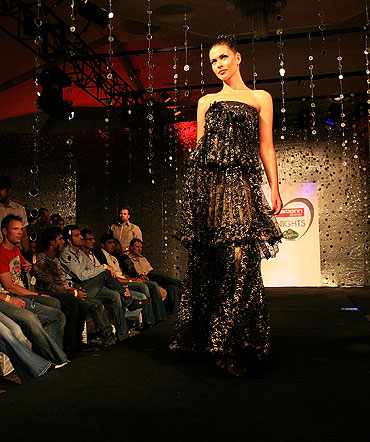 A model walks the ramp in a  Ramona Narang design