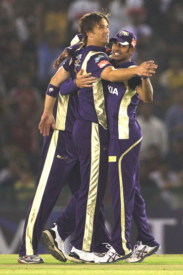 Shane Bond celebrates after picking up Ravi Bopara