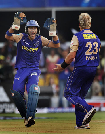 Shane Warne celebrates after picking up Suresh Raina