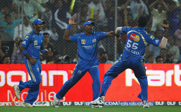 Mumbai Indians players celebrate after a wicket