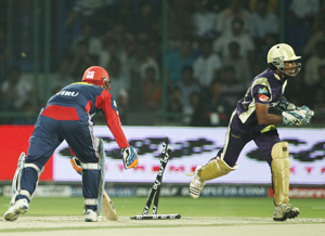 Virender Sehwag of the Delhi Daredevils is stumped by Wriddhiman Saha