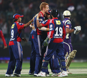Andrew McDonald of the Daredevils celebrates with his team after taking the wicket of Manoj Tiwary