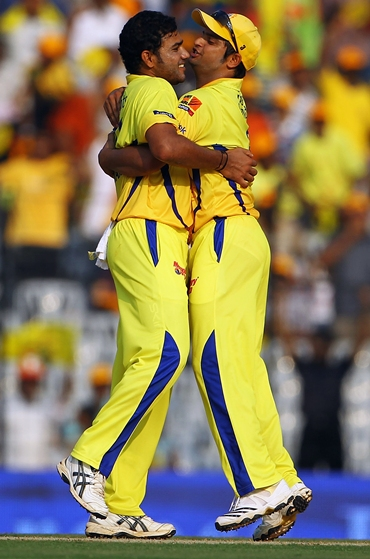 Shadab Jakati is congratulated by Suresh Raina