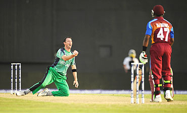 Ireland's Alex Cusack (left) celebrates after catching West Indies' Dwayne Bravo