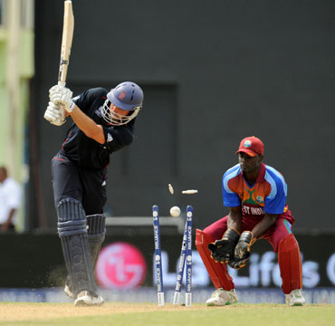Michael Lumb is clean bowled by Chris Gayle
