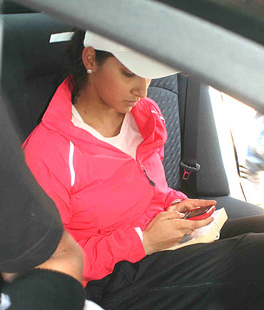 Sania Mirza waits in her car outside the stadium