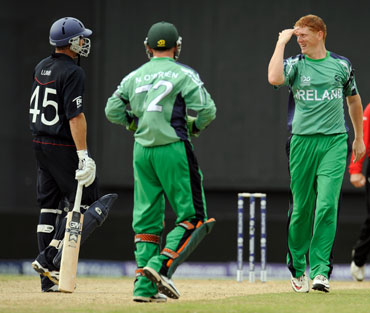 Ireland players celebrate after picking up Michael Lumb