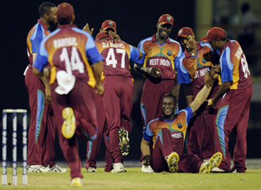 West Indies players celebrate after winning a match