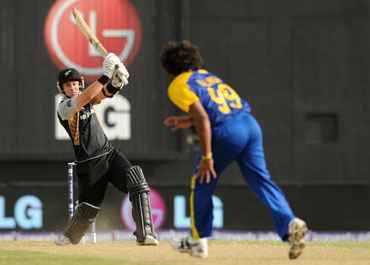 Nathan McCullum hits a six