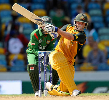 Michael Hussey plays a sweep shot