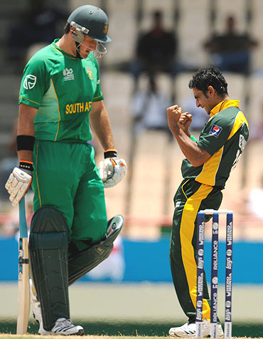 South Africa's Graeme Smith leaves the field after being dismissed by Pakistan's Abdur Rehman