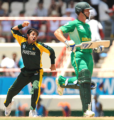 Ajmal celebrates after dismissing Mark Boucher as Albie Morkel (right) looks on