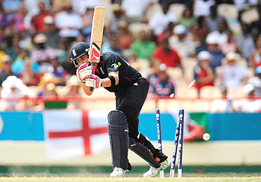 Craig Kieswetter is bowled by Lasith Malinga