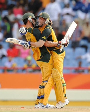 Mike Hussey and Mitchell Johnson celebrate after the winning runs are hit