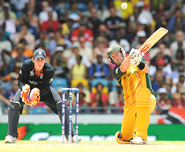 Cameron White sends a Michael Yardy delivery beyond the boundary