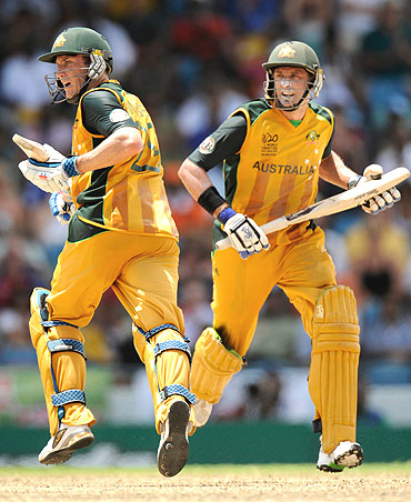 David Hussey (left) and Michael Hussey run between the wickets