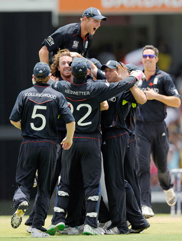 England players celebrate after a fall of a wicket