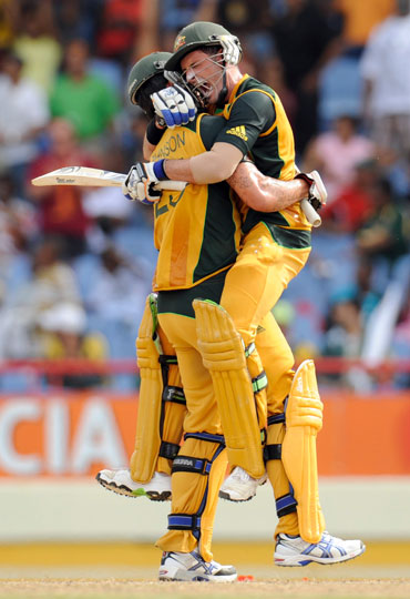 Mike Hussey celebrates after winning the semi-final match against Pakistan