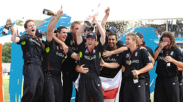 The English cricket team celebrates after winning the World T20 championship on Sunday
