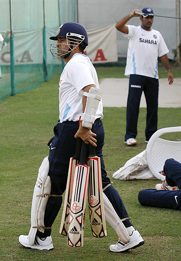Sachin Tendulkar walks in for some batting practice during a net session in Motera on Monday