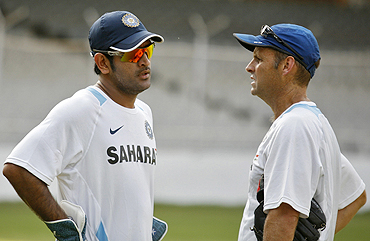 India captain Mahendra Singh Dhoni and coach Gary Kirsten share a thought during a practice session in Motera on Monday