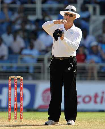 Umpire Tony Hill gestures for third umpire
