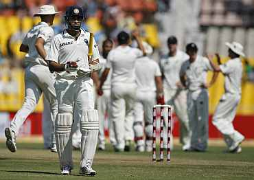 VVS Laxman walks back to the pavillion after being dismissed