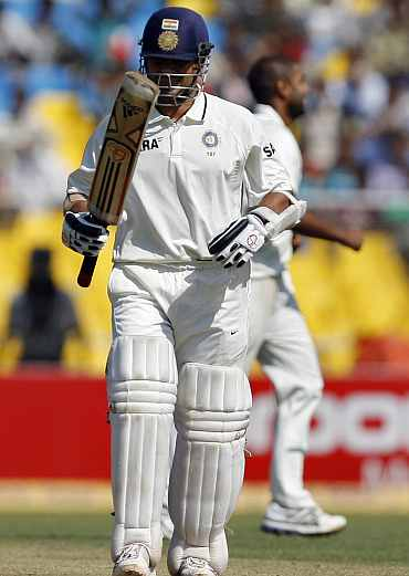 Sachin Tendulkar checks his bat after being dismissed by Jeetan Patel