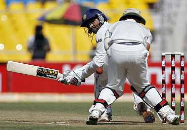 Harbhajan Singh plays a sweep shot