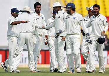 India's Pragyan Ojha (3rd from left) celebrates with teammates after claiming the wicket of Williamson on Sunday