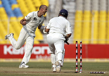 New Zealand's Chris Martin (left) celebrates dismissing Sachin Tendulkar on Sunday