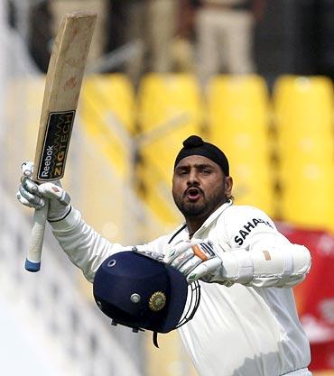 Harbhajan Singh celebrates after scoring his century