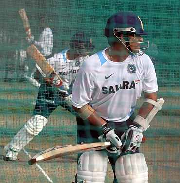 Sachin Tendulkar and Rahul Dravid bat during a practice session in Hyderabad