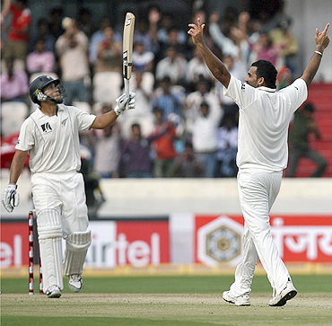 Zaheer Khan (right) celebrates after dismissing New Zealand's Ross Taylor