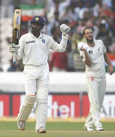 Harbhajan Singh celebrates after making a half-century