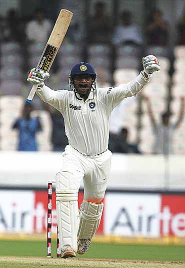 Harbhajan Singh celebrates after scoring his century against New Zealand in Hyderabad