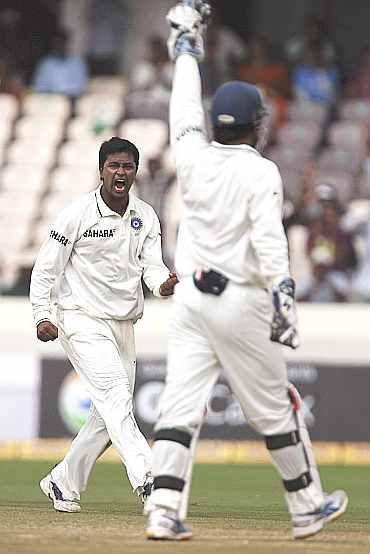 Pragyan Ojha reacts after dismissing Martin Guptil